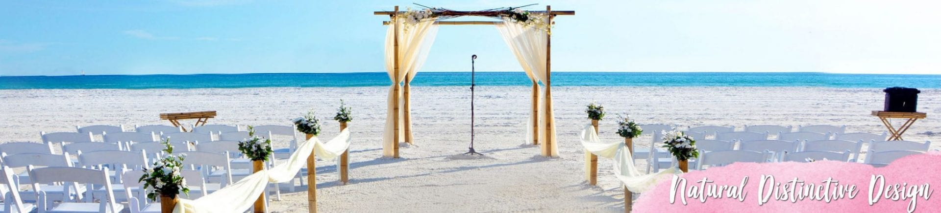 Natural bamboo wedding arch with flowers on the beach