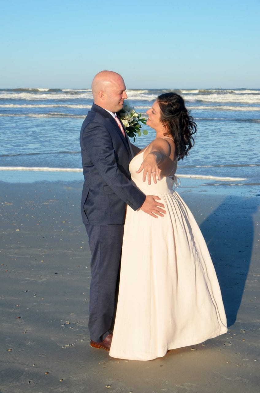 Bride and groom saying vows on Florida beach in the sea