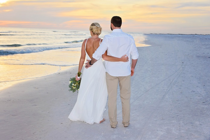 Clearwater sunset wedding couple on beach