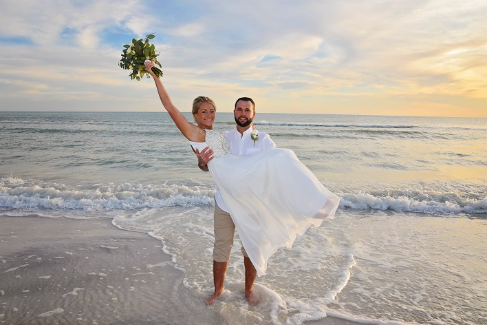 Clearwater Beach wedding couple in Gulf water
