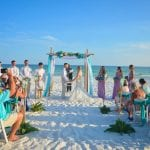 Destin, Florida beach weddings with teal and lavender decor.
