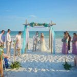doing the sand ceremony during our Destin, Florida beach weddings.