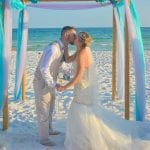 First kiss as Mr. and Mrs. during our Destin, Florida beach weddings.