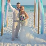 An excited groom as he celebrates with his wife during one of our Destin, Florida beach weddings.