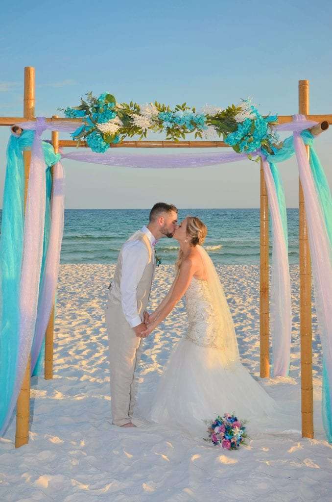First kiss as mr.and mrs. at our Destin, Florida beach weddings.