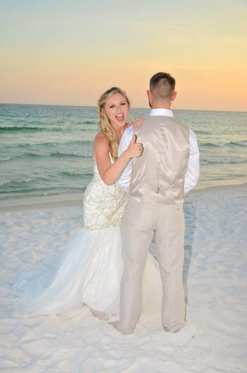 Bride and groom at sunset beach wedding in Florida
