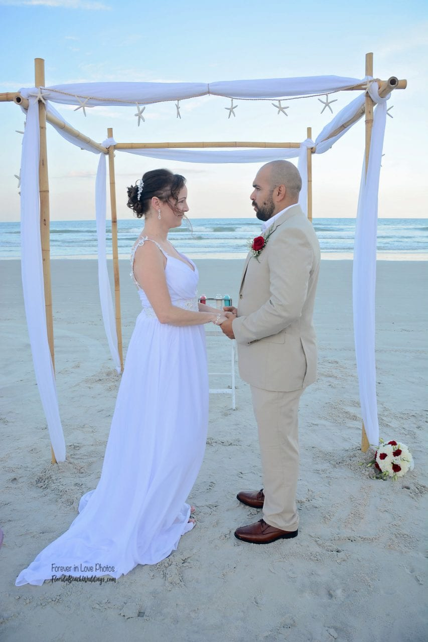 Wedding couple saying vows on Daytona Beach