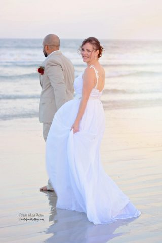Couple in ocean after Daytona Beach wedding in Florida
