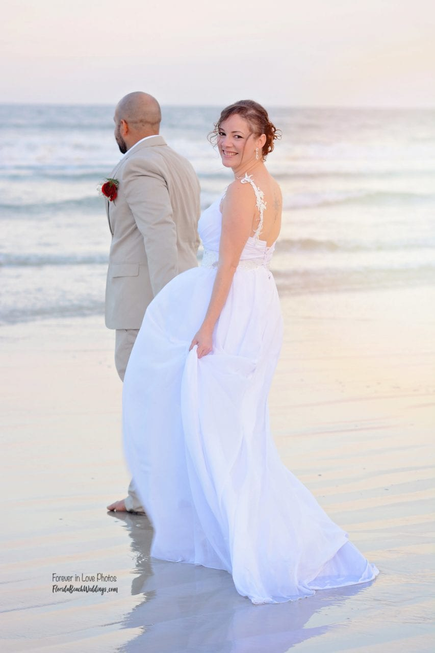 Bride and groom married on the beach in the waves on Daytona Beach