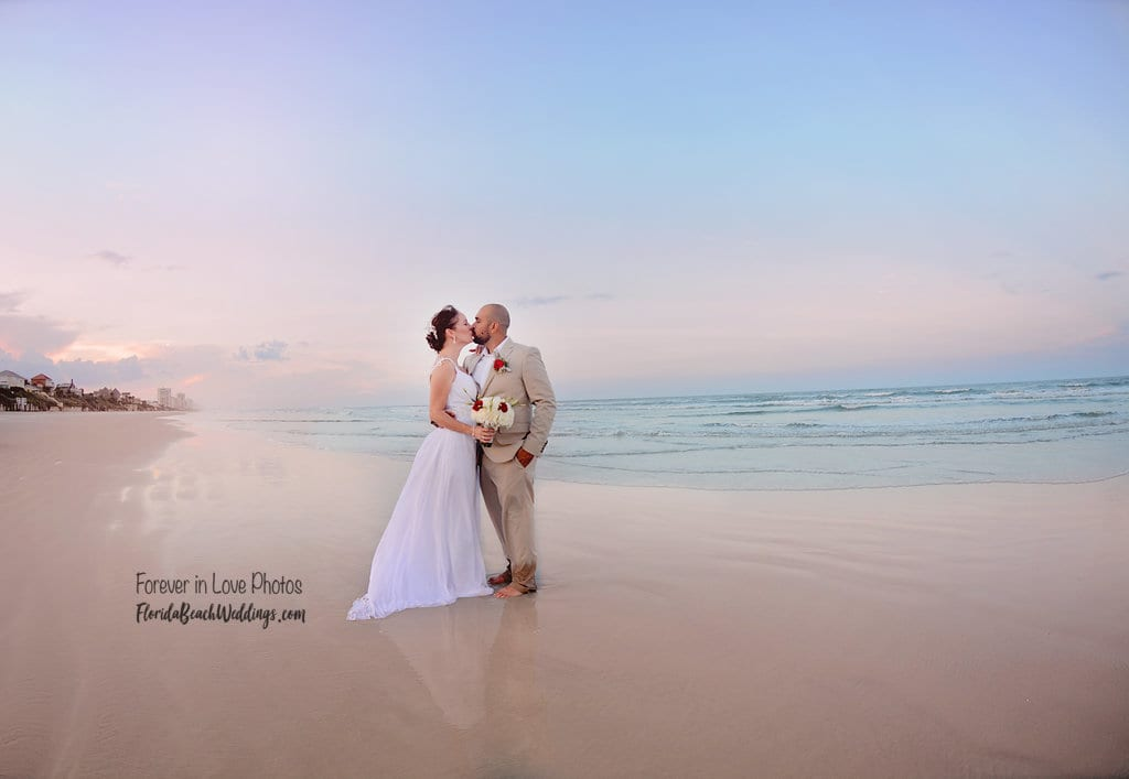 Couple kissing after wedding on Florida beach in Daytona