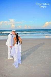 A bride kisses her military husband during one of our Daytona Beach Weddings.