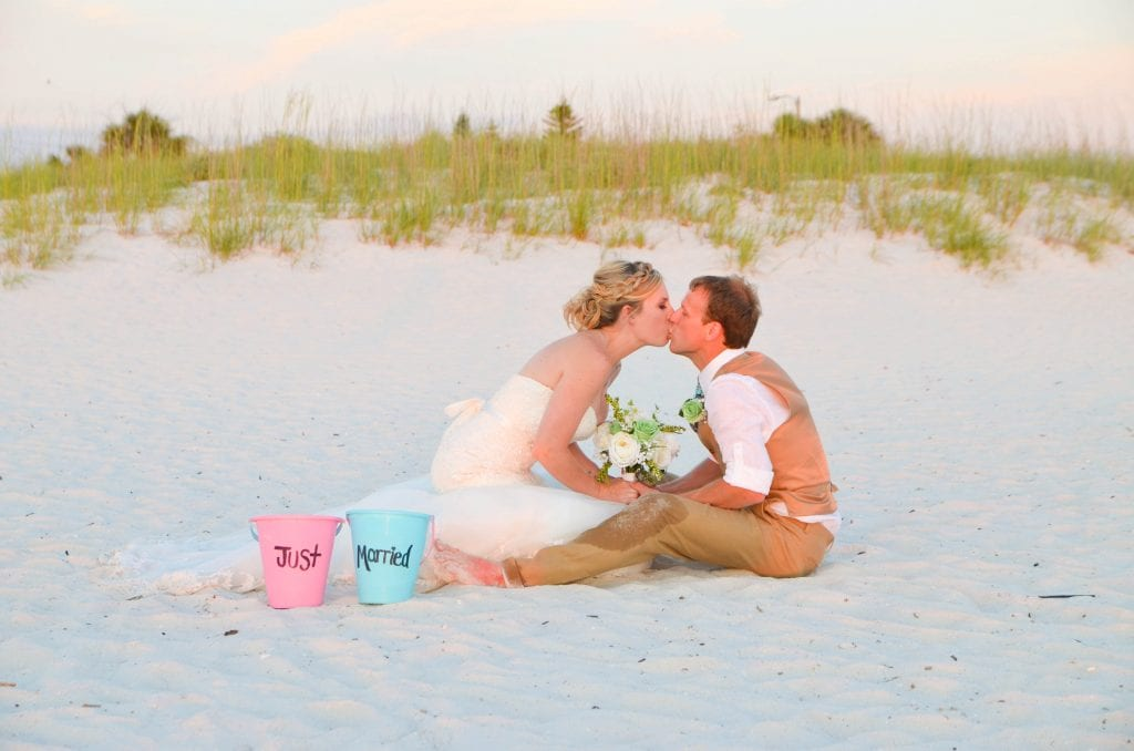 Pass-a-grille sunset beach wedding couple in Florida/