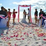 Treasure Island Beach Wedding in Clearwater Florida with bamboo canopy, chairs and and aisle way.