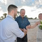 A dad gives his daughter away at one of our Palm Coast, Florida beach weddings.