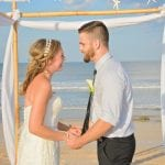 A bride and groom are about to share their first kiss during our Palm Coast, Florida beach weddings.