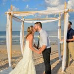 A bride and groom share a kiss during one of our Palm Coast, Florida beach weddings.