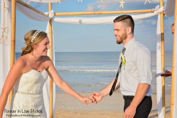 Wedding couple under canopy on Venice Beach, Florida