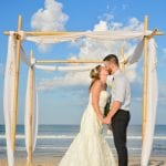 Palm Coast, Florida beach weddings are the ideal spot to share a first kiss.