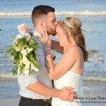 posing for photos during our Palm Coast, Florida beach weddings.