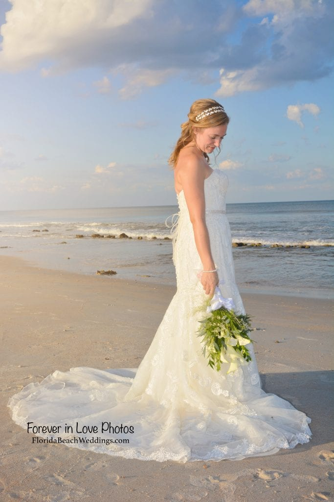 Beach bride style with natural flowers and an ivory lace dress from one of our Palm Coast, Florida beach weddings