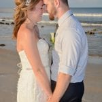 A bride and groom share a romantic moment down by the water during one of our Palm Coast, Florida beach weddings
