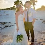 a bride and groom pose casually during one of our Palm Coast, Florida beach weddings