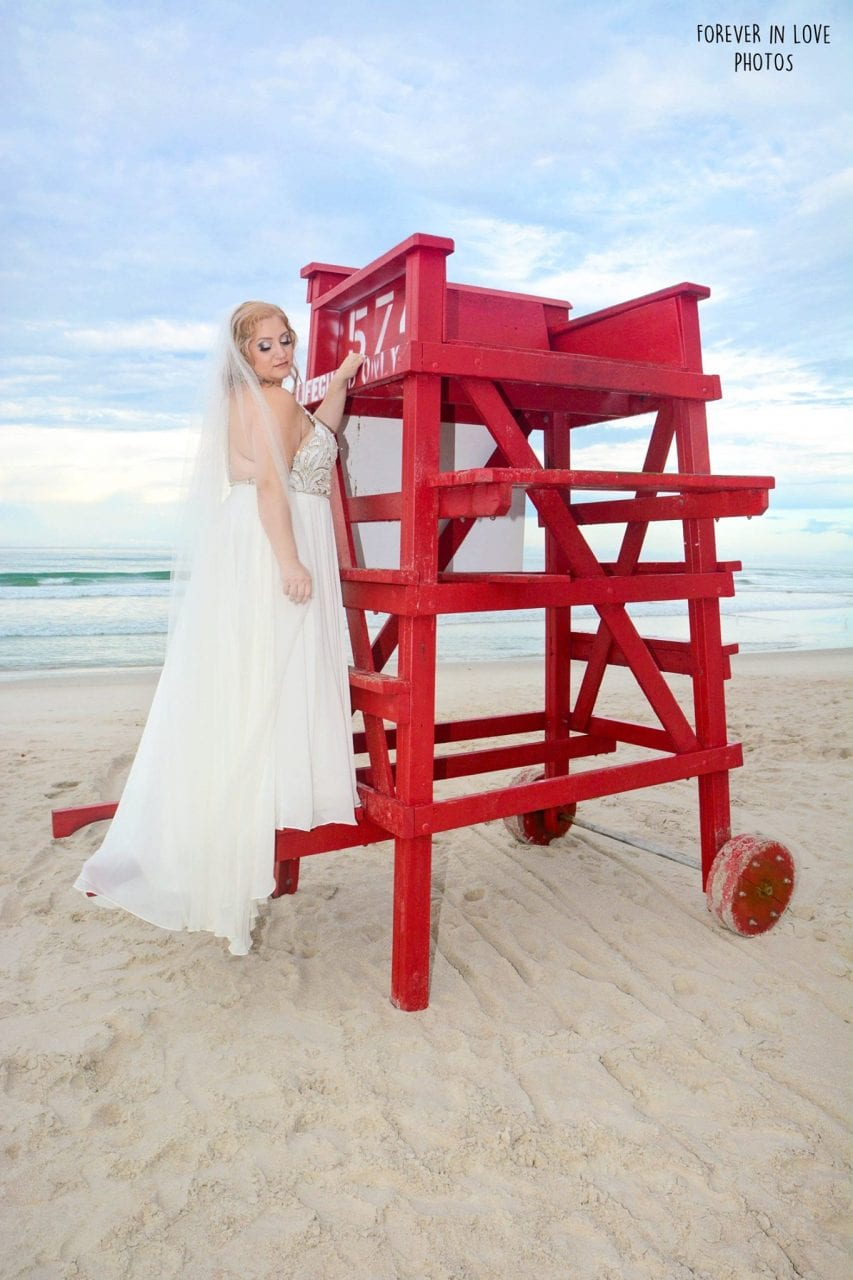 Bride on the lifeguard stand on the beach