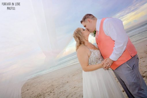 Couple kissing at Daytona Beach Wedding
