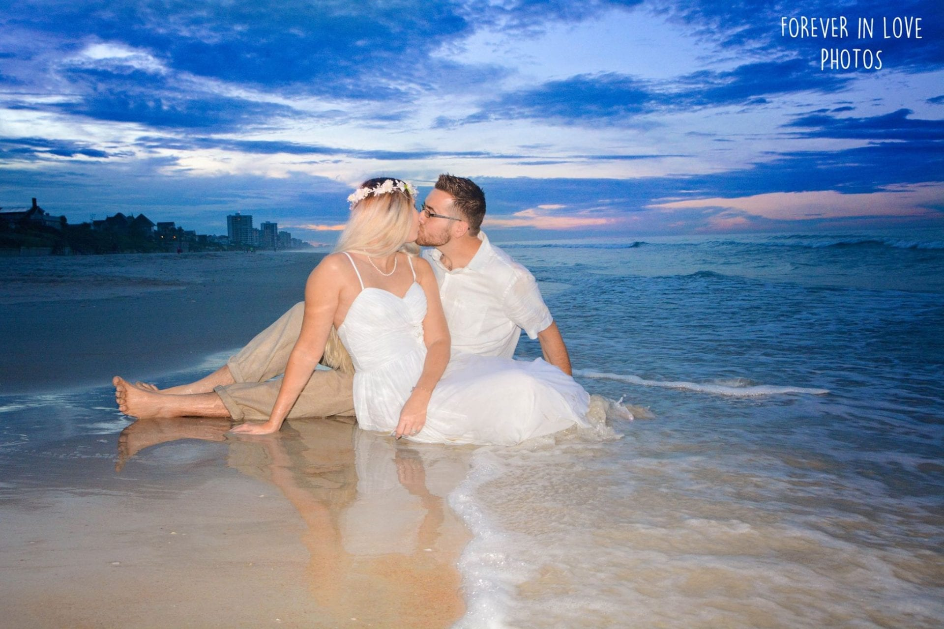 Wedding couple kissing at sunset on Daytona Beach