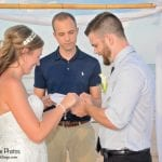 A bride and groom exchange rings during our Palm Coast, Florida beach weddings.