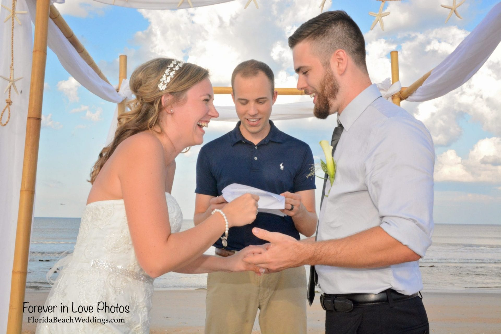Couple saying vows at beach wedding St. Augustine