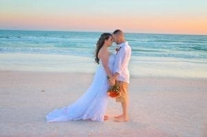 A bride and groom share an intimate moment during one of our Siesta Key Beach Weddings in Florida.