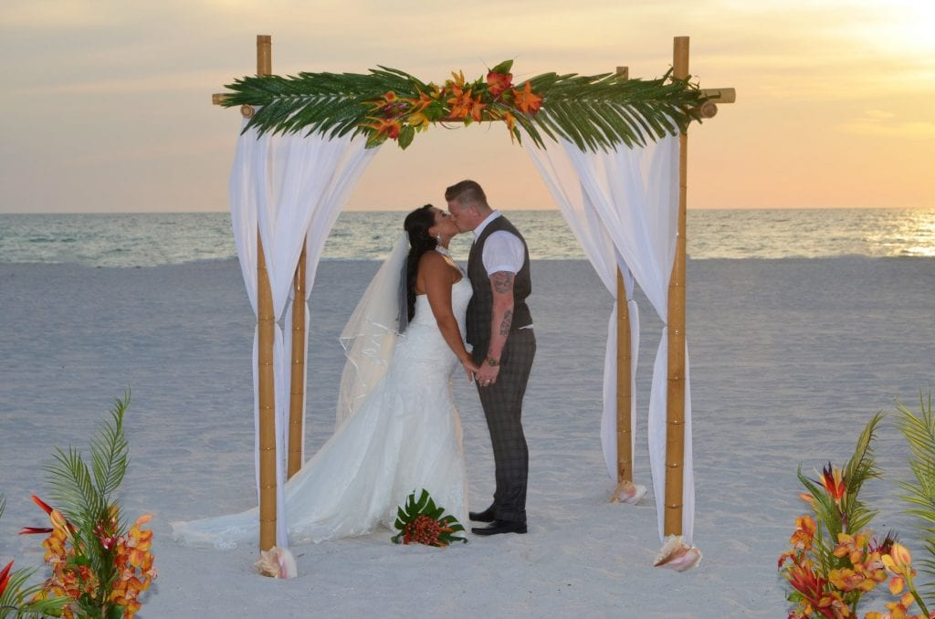 Clearwater Beach Weddings during the sunset with couple kissing