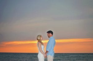 A bride and groom pose for their Sunset Clearwater Beach Weddings photo.