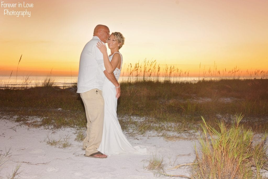 Siesta Key Wedding during the sunset are the ideal time to pose with your groom during your Florida beach wedding.