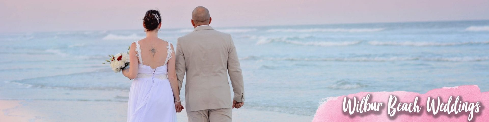 Couple walking along the shore at Wilbur beach wedding ceremony