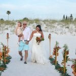 The happy family to be makes their way down the aisle at our Beach Wedding in Clearwater, Florida.