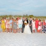 Family and friends gather at this Beach Wedding in Clearwater, Florida for a group photo.