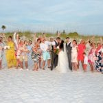 "A happy ""Hooray"" from the crowd in front of the dunes at this Beach Wedding in Clearwater, Florida."