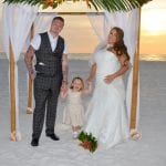 At this Beach Wedding in Clearwater, Florida the happy couple takes their first family photo.