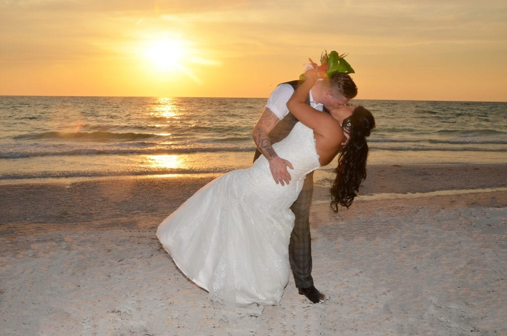 Our Beach Wedding in Clearwater, Florida shows off this Bride and Groom and a romantic sunset kiss.