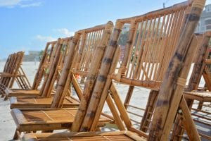Destination Florida beach weddings with bamboo chairs.