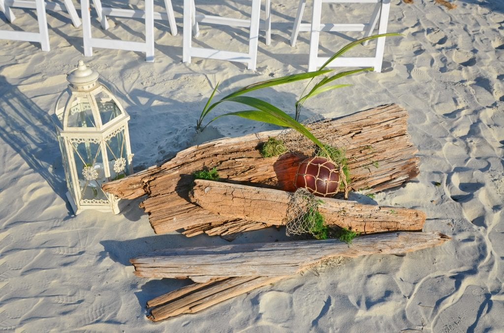 Driftwood beach wedding decorations on the sand in Florida