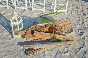 Driftwood beach wedding packages in Florida that are all-inclusive with beautiful decor.