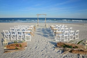 Our Driftwood beach wedding packages are all-inclusive and come with beautiful decor, white chairs, burlap and babys breath.