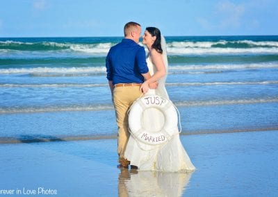 A bride and groom share a moment after their Daytona Beach Elopement Ceremony.