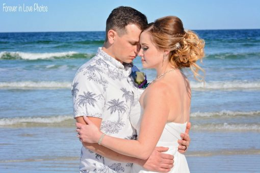 Wedding couple hugging on Daytona Beach