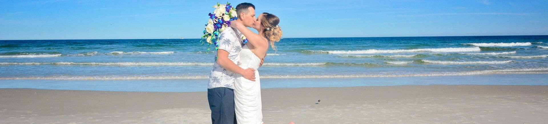 Wedding couple kissing on Daytona Beach Florida