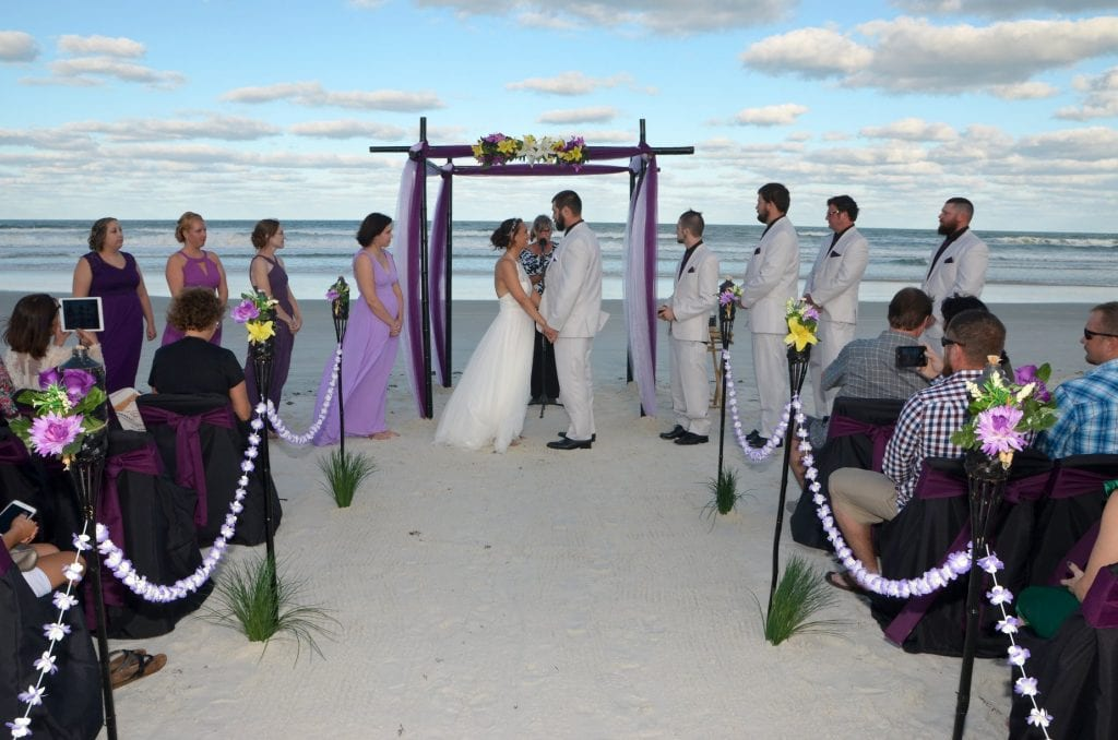 Daytona Beach Wedding Packages with black bamboo, aisle way, chairs and officiant.