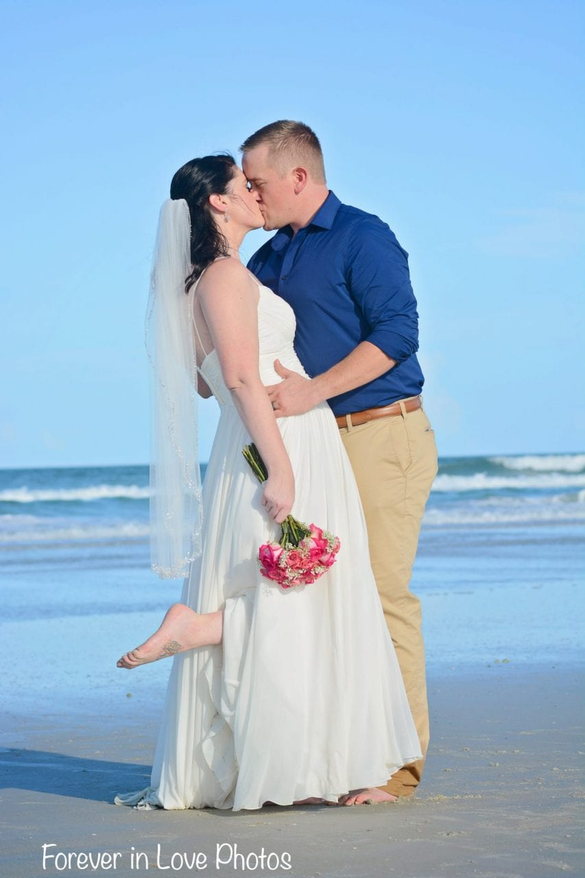 Wedding couple kissing on Daytona Beach